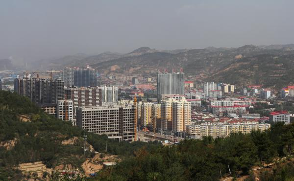 Luliang is in recession, but developers continue to build apartment blocks even though demand for real estate is drying up.