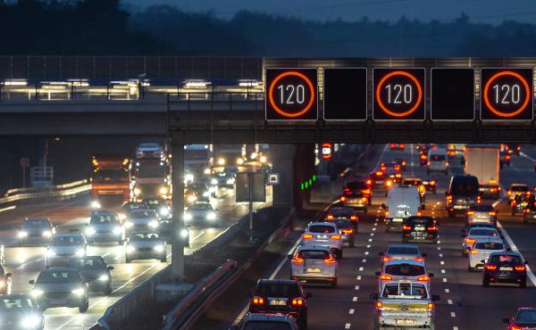 Cars drive near Frankfurt Airport on Tuesday in Germany. Most German highways have no speed limit, and a proposal to cap speeds at about 80 mph has sparked controversy.