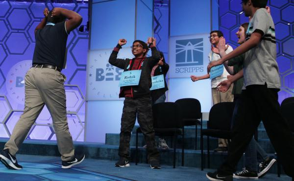 During the Scripps National Spelling Bee's 92nd year, eight co-champions took home the spelling bee cup after a record-breaking and exhausting night that ended in the 20th round.