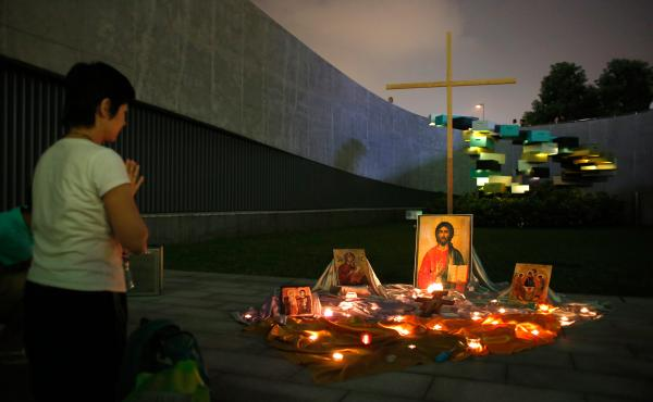 A student prays in front of a temporary altar during a rally outside government headquarters in Hong Kong on Sept. 24.