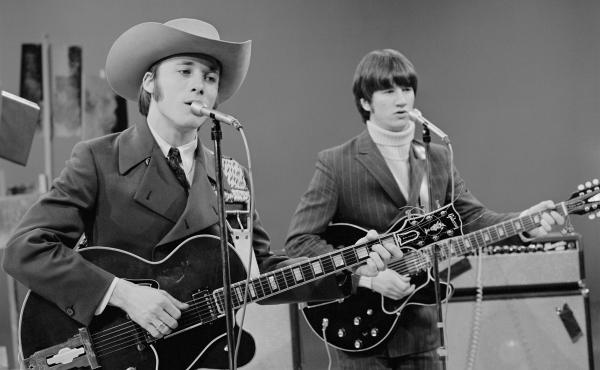 Stephen Stills (left) performs with Buffalo Springfield on The Smothers Brothers Comedy Hour in 1967.