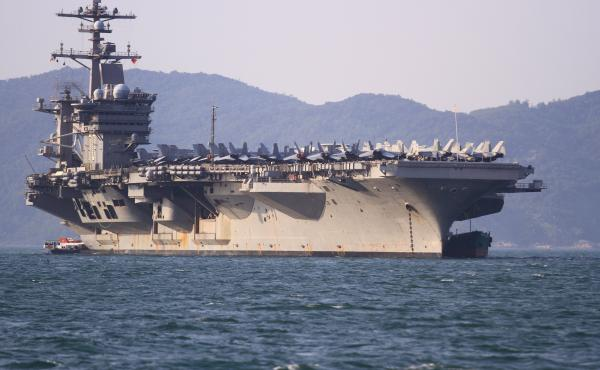 The USS Carl Vinson (CVN-70), the U.S. Navy's nuclear-powered Nimitz-class aircraft carrier, anchored off the coast in Danang, Vietnam on Monday.