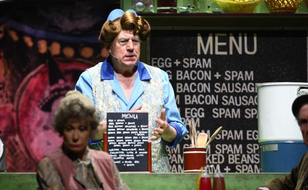 "Terry Jones performs the famous ""Spam"" sketch during 2014's Monty Python Live (Mostly) stage show. Jones died at the age of 77 after suffering from dementia."