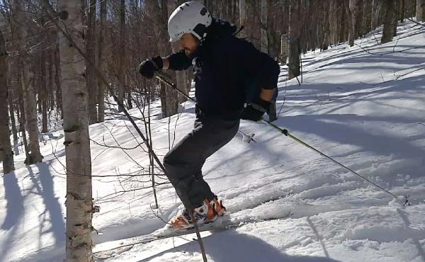 Chris Morris, an experienced back country skier, cuts back in a glade on Lyon Mountain in upstate New York.