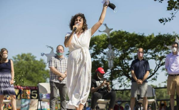 Minneapolis City Council Member Alondra Cano speaks to a crowd that gathered at Powderhorn Park last June. During the event, Cano and eight other Minneapolis City Council members declared their commitment to defunding and dismantling the Minneapolis Polic