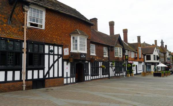 The George Hotel, a 17th century stagecoach inn, is one of the few historic buildings on Crawley's main street. Most of the town was built after World War II to house people displaced by bombing in London. In recent years, immigrants settled in Crawley an