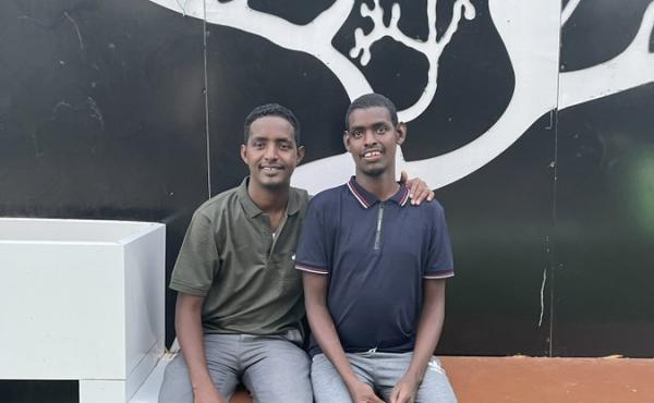 Omar Mohamed, left, and his brother, Hassan. In the graphic memoir he coauthored, When Stars Are Scattered, Mohamed shares what their life was like in the refugee camps in Kenya — and their journey to resettlement in the U.S.