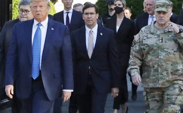 President Trump and his advisers, including Attorney General William Barr, walk through Lafayette Square on June 1 after it was cleared of protesters. Trump then posed for photos holding up a Bible in front of St. John's Episcopal Church.