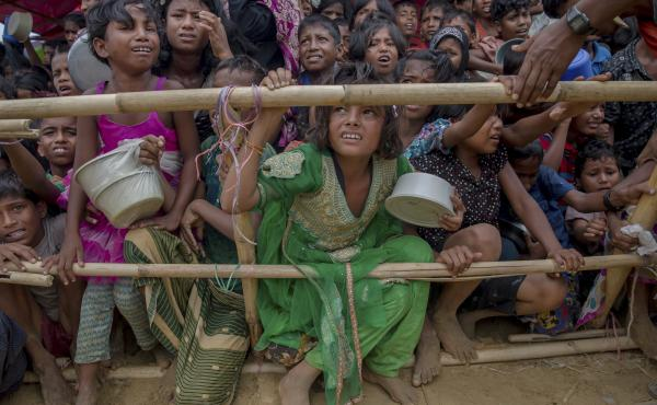 Rohingya Muslim children, who crossed over from Myanmar into Bangladesh, wait squashed against each other to receive food handouts distributed to children and women by a Turkish aid agency at Thaingkhali refugee camp, Bangladesh, in October.