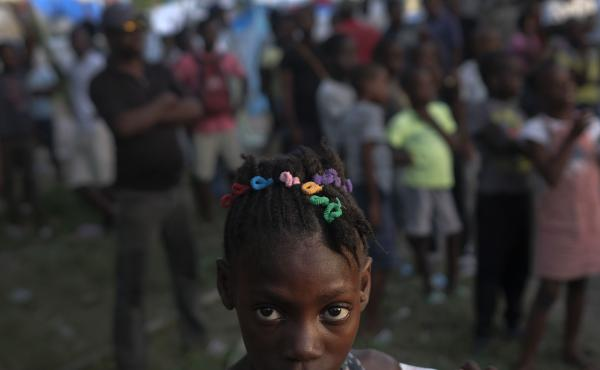 A girl waits with other earthquake victims for the start of a food distribution in Les Cayes, Haiti, in August, a week after a 7.2 magnitude earthquake hit the area.