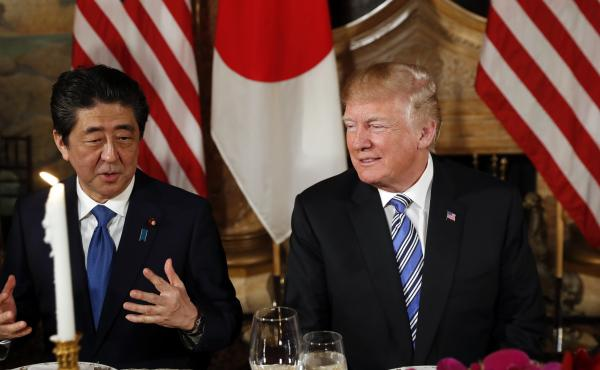 President Trump talks with Japanese Prime Minister Shinzo Abe before dinner at Trump's private Mar-a-Lago club, in April in Palm Beach, Fla.