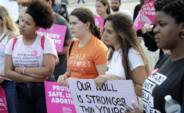 Demonstrators listen to speeches during a rally in support of abortion rights on Thursday in Miami.