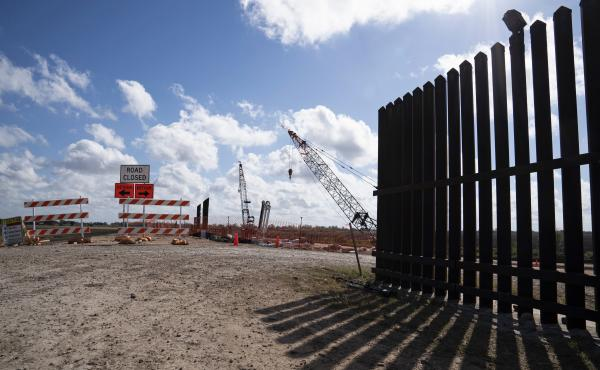 The existing border wall (right) is seen near the construction site of new wall panels south of Donna, Texas, on Nov. 20. There is widespread skepticism on the border that President Trump will get anywhere near the 450 miles of wall he wants by next Novem