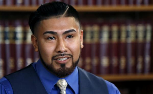 Luis Vicente Pedrote-Salinas responds to a question during a news conference on July 11, 2017, in Chicago. Pedrote-Salinas is a Mexican immigrant ordered to leave the country who filed a lawsuit against Chicago police alleging he was wrongly listed in a g