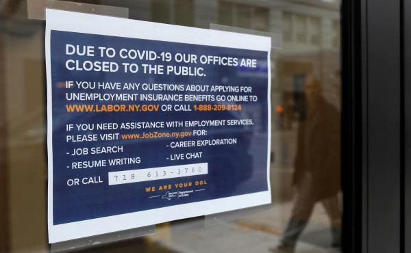 "A ""closed"" sign is posted at the entrance of a New York State Department of Labor office in Brooklyn. With millions of people filing for unemployment benefits, state employment agencies have been overwhelmed around the country."