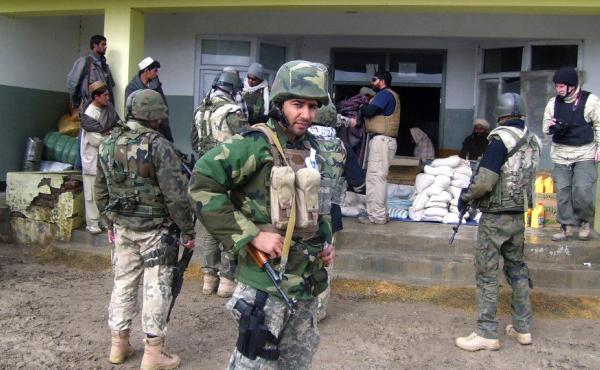 Janis Shinwari wearing his body armor in Afghanistan in 2008. He worked with U.S. troops in some of the most dangerous parts of the country, and the Taliban put him on a 'kill list.'