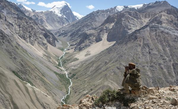 A Wakhi man looks out at the mountains in the Wakhan corridor of Afghanistan. Uyghurs leaving China have trekked through the region. Now many Uyghurs in Afghanistan fear the Taliban could deport them to China.