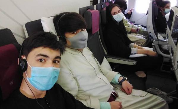 Members of the Afghanistan National Institute of Music on the plane to Doha.