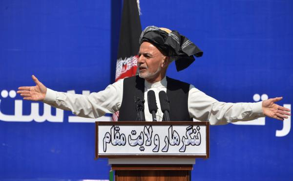 Afghan President Ashraf Ghani speaks earlier this month in Jalalabad. Ghani's dispute with Abdullah Abdullah over election results has been cited as one reason for the delay in organizing prisoner releases with the Taliban, a key stipulation in a peace de