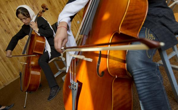 Students practice the cello during class at the Afghanistan National Institute of Music on Sept. 26, 2010 in Kabul.