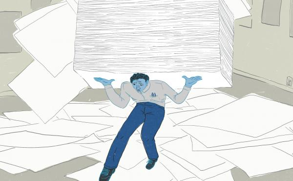 Man carrying huge stack of papers and papers strewn about