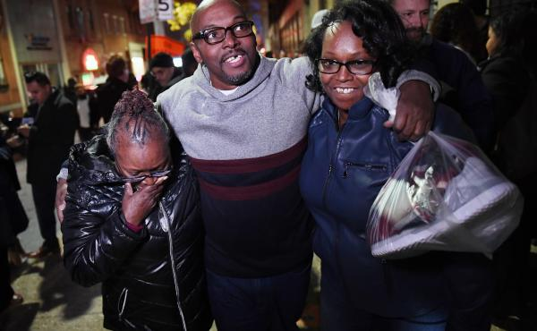 Andrew Stewart (center) walks with his mother and sister on Monday after he and two other black men were exonerated in a 1983 murder for which they were sentenced to life in prison.