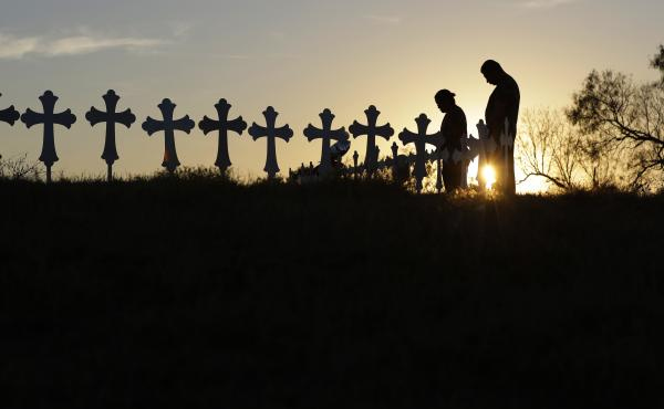 Kenneth and Irene Hernandez pay their respects as they visit a makeshift memorial with crosses placed near the scene of a shooting at the First Baptist Church of Sutherland Springs, Texas. A man opened fire inside the church in the small South Texas commu