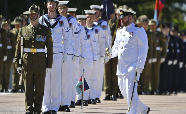 An honor guard is formed at Defence Headquarters in Canberra, Australia, before findings from the Inspector-General of the Australian Defence Force Afghanistan Inquiry are released on Thursday. A report found evidence that 25 soldiers unlawfully killed 39