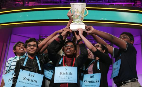 The 2019 Scripps Spelling Bee co-champions hold up their trophy at the Gaylord National Resort & Convention Center in National Harbor, Md. After pausing in 2020, the competition is back on this year. The finals are Thursday night in Orlando, Fla.