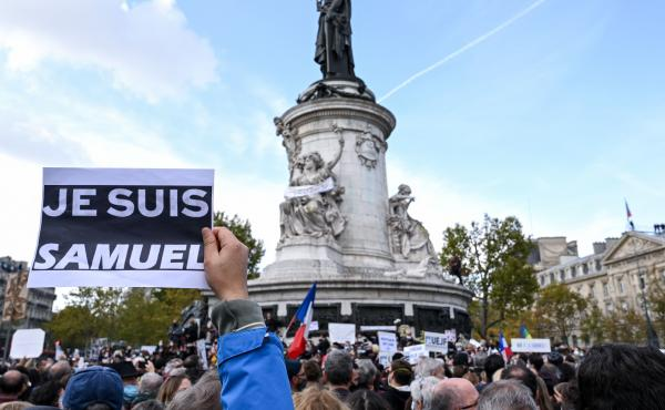 "Demonstrators like the one shown here carried ""I am Samuel"" signs as they gathered on Place de la République in Paris on Sunday to pay tribute to slain history teacher Samuel Paty. Similar gatherings took place in several other cities as France reels fro"