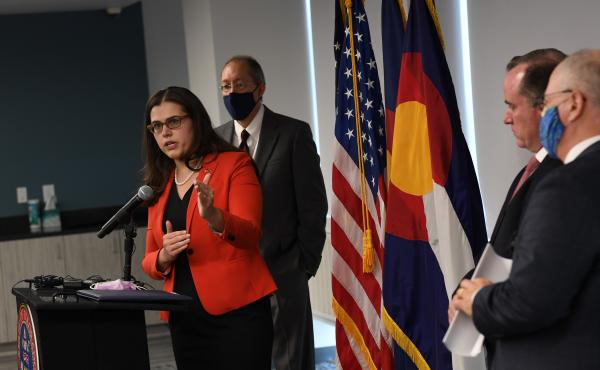 Colorado Secretary of State Jena Griswold, left, speaks during a press conference about to the Mesa County election breach investigation on August 12, in Denver.