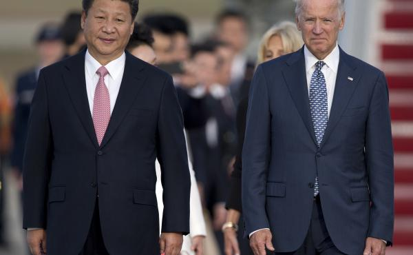 Chinese President Xi Jinping and then-Vice President Joe Biden in 2015 at an arrival ceremony at Joint Base Andrews. China recognized Biden's election as president Friday.