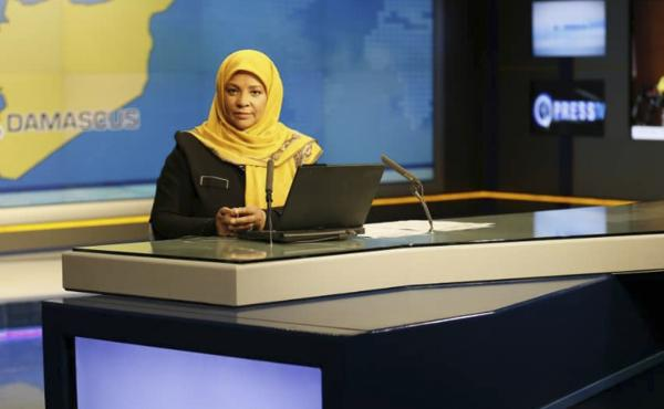 American-born news anchor Marzieh Hashemi sits in a studio in Tehran where she works for Iran's state television. She was arrested Sunday during a visit to the U.S., her family says. She is testifying behind closed doors to a grand jury in Washington, D.C