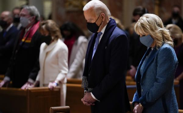 President Joe Biden and his wife, Jill Biden, shown here on Jan. 20, 2021, attend Mass at the Cathedral of St. Matthew the Apostle during Inauguration Day ceremonies in Washington, D.C.