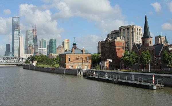 The Shanghai Rowing Club (middle) was rescued after preservationists fought a proposed demolition. In the background to the left is the futuristic skyline of Shanghai's financial district, Lujiazui.
