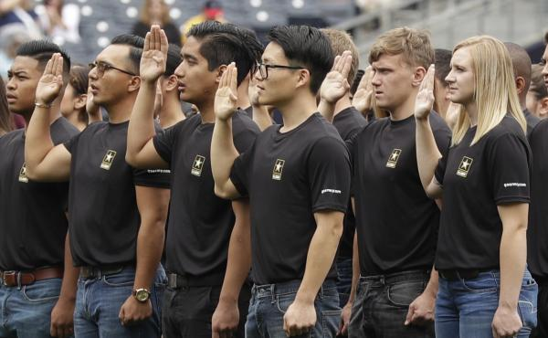 New Army recruits take part in a swearing-in ceremony on June 4, 2017, in San Diego.