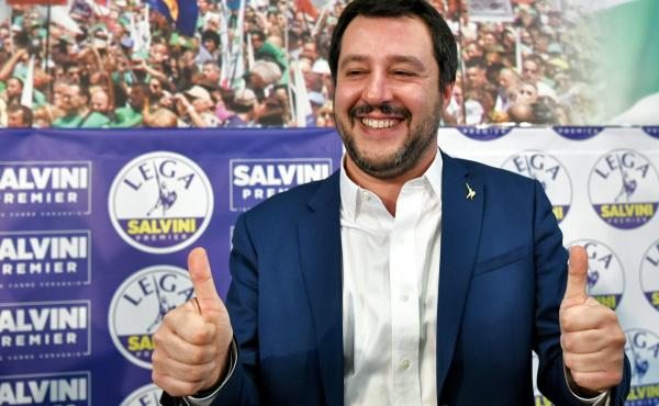 "Italian far-right League party leader Matteo Salvini gives the thumbs-up in Milan on Monday. Salvini said his right-wing coalition had the ""right and the duty"" to form a government after taking 37 percent of the vote in the weekend election."