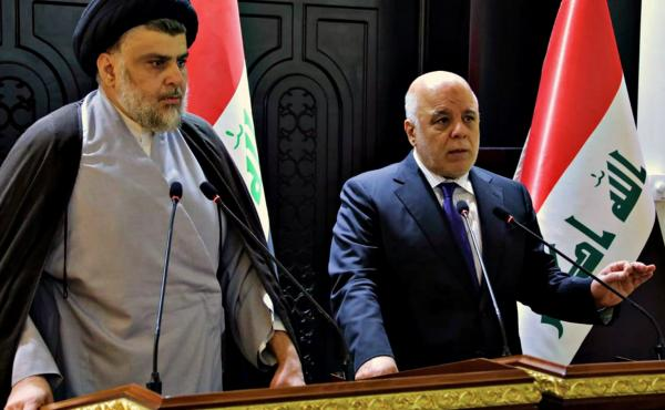 In this photo provided by the Iraqi government, Iraqi Prime Minister Haider al-Abadi (right) and Shiite cleric Muqtada al-Sadr hold a press conference in Baghdad on May 20. Sadr's coalition won the largest number of seats in Iraq's parliamentary elections