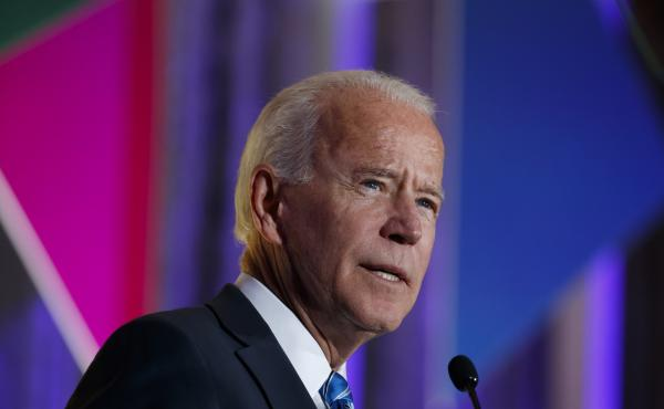 """Former vice president and current Democratic presidential candidate Joe Biden apologized on Tuesday for using the word """"lynching"""" in 1998 to describe the impeachment of then-President Bill Clinton. Above, Biden speaks at this year's Democratic Women's Lea"""