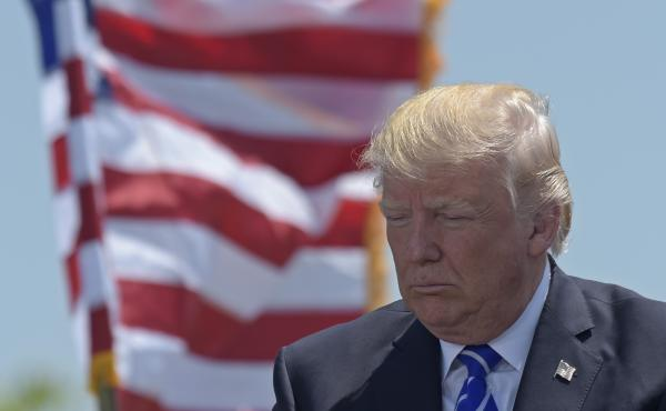 President Trump gives the commencement address at the U.S. Coast Guard Academy in New London, Conn.