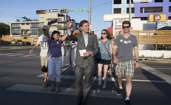 Texas Attorney General candidate Justin Nelson leads a pub crawl across three congressional districts in downtown Austin - the Pub Crawl to End Gerrymandering.