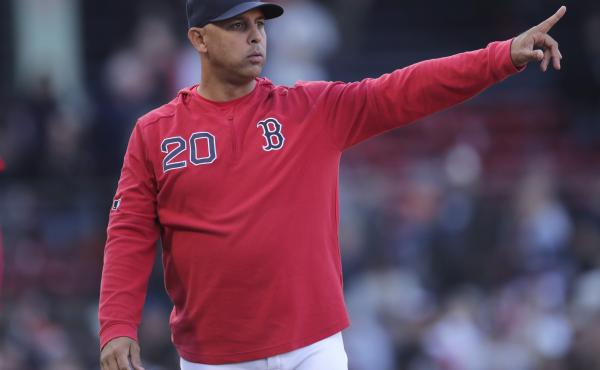The Boston Red Sox have reportedly rehired Alex Cora as the team's manager. He is seen above as he gestures toward the outfield after a win over the San Francisco Giants in a game at Fenway Park in Boston in 2019.