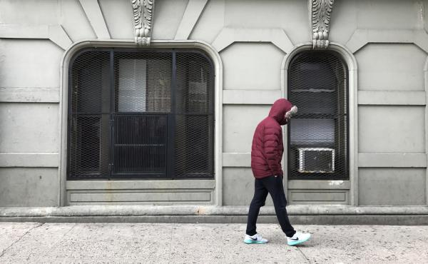 Eduardo walks by the spot where he was arrested for selling cocaine when he was 17 in New York City. He was recently pardoned by New York Gov. Andrew Cuomo as part of a program that helps people who committed a nonviolent crime when they were 16 or 17 and