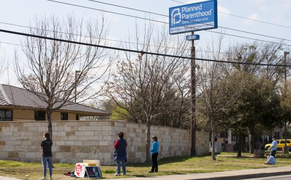 Anti-abortion-rights activists pray outside a Planned Parenthood clinic that offers abortions in 2016 in Austin. Texas has suspended most abortions during the coronavirus pandemic.