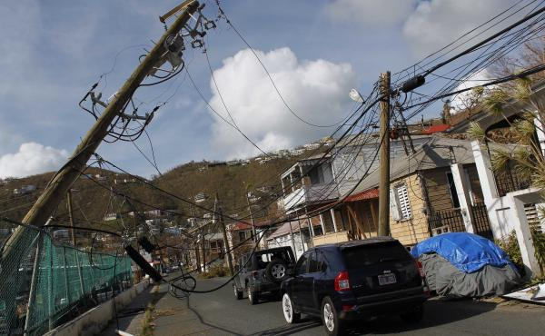 Damaged power lines hang over a street following Hurricane Irma hit in Charlotte Amalie, St. Thomas, U.S. Virgin Islands on Sept. 10, 2017. The storm ravaged such lush resort islands as St. Martin, St. Barts, St. Thomas, Barbuda and Anguilla.