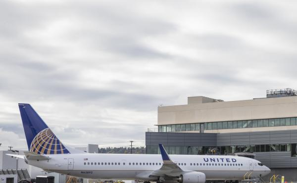 A United Airlines Boeing 737 is parked outside the Boeing 737 Delivery Center in Seattle in 2015. A passenger was forcibly removed from a flight from Chicago to Louisville, Ky., on Sunday.