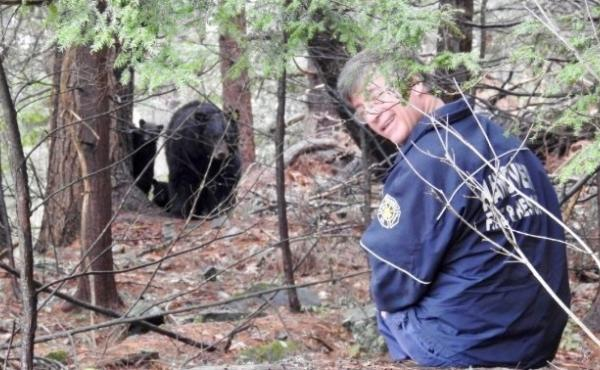 Hanover, N.H., Deputy Fire Chief Michael Hinsley in the woods with Mink the bear.