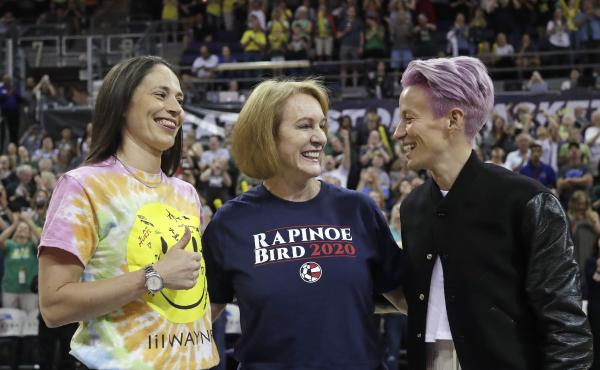 Seattle Mayor Jenny Durkan, center, wears a T-shirt honoring Megan Rapinoe, right, of the U.S. women's World Cup champion soccer team and the Seattle Storm's Sue Bird, left, before a WNBA game on July 12.