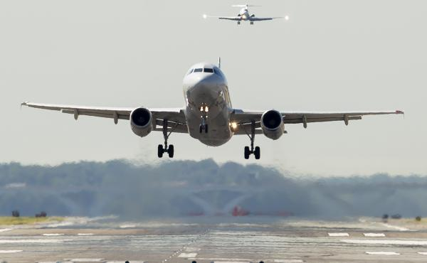 An American Airlines Airbus A319 airplane takes off from Ronald Reagan Washington National Airport in Arlington, Va.