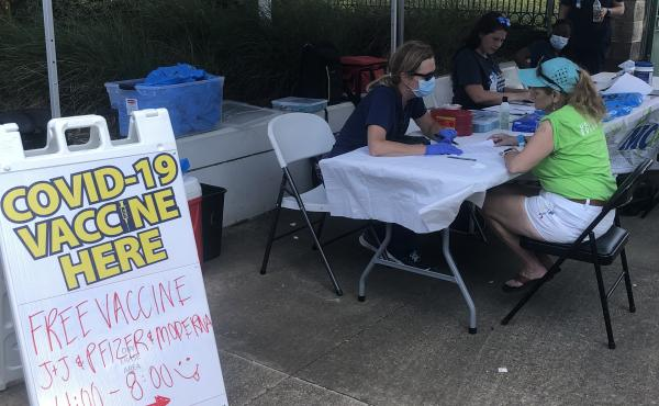 Health officials in Mobile recently set up a pop-up clinic at a food truck festival. Despite officials making a big effort encouraging Alabama residents to get vaccinated, numbers remain low as COVID infections increase.